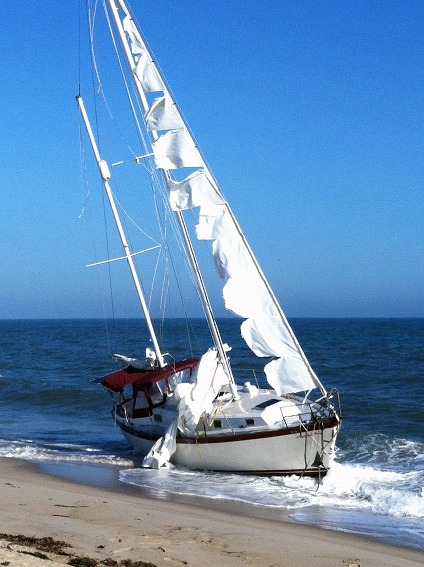 Abandoned vessel at sea washes ashore