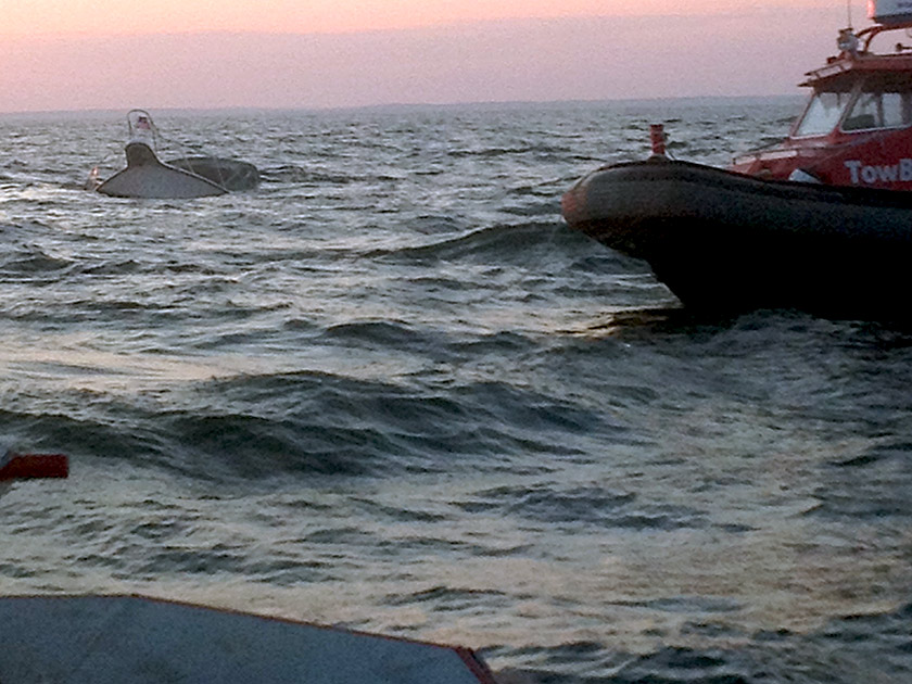 Two Towboat US Falmouth vessels arrive on the scene of a sinking boat